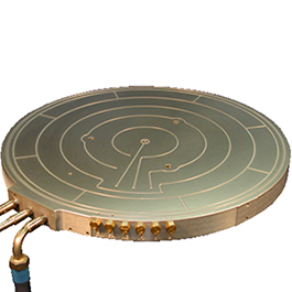 This custom-made wafer heating pedestal is made of bronze for high temperature gas deposition and etch applications.